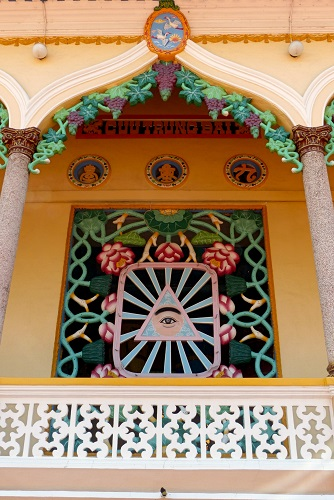 Temple window decorated with divine eye at Cao Dai Holy See, Vietnam