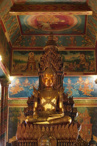 Painted ceiling and Buddha in Wat Phnom,Phnom Penh, Cambodia