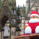 Giant Zippy dressed as Santa by town hall at Manchester Christmas Market, England