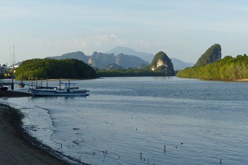 View of river and Khao Khanab Nam Cliffs from Krabi town, Thailand