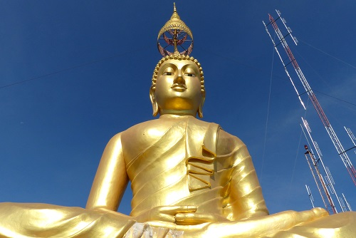 Giant golden Buddha at the Tiger Cave Temple in Krabi town, Thailand
