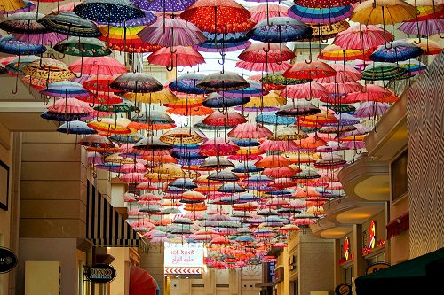 Colourful umbrellas hanging from the ceiling of Dubai Mall in UAE