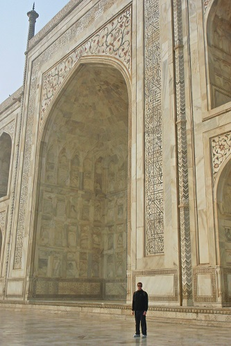Chris standing by huge arch at Taj Mahal in Agra, India