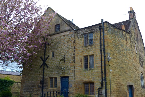 Bakewell bath house and cherry blossom in Peak District, England