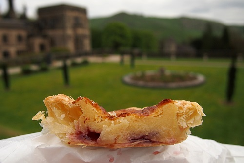 Bakewell pudding with house and garden behind in Peak District, England