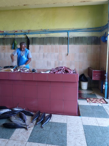Man preparing fish at Male fish market in the Maldives