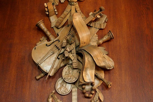 Carving of musical instruments at Lyme, Peak District