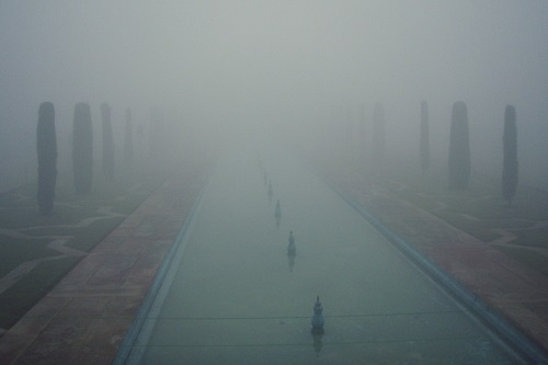Taj Mahal obscured by mist in Agra, India