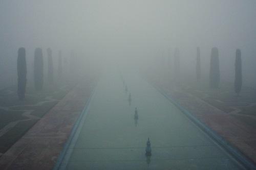 Taj Mahal obscured by mist in Agra, India