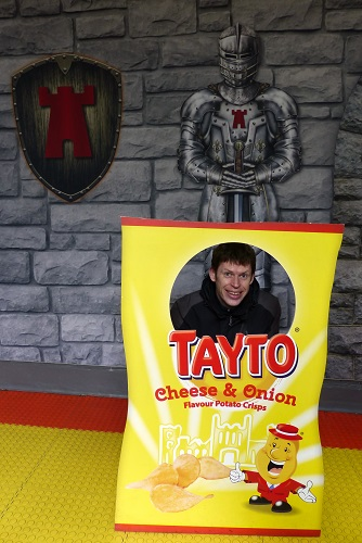 Chris inside a giant bag of crisps on Tayto Castle tour in Northern Ireland