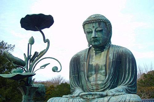 Great Daibutsu giant Buddha statue practising zazen in Kamakura, Japan