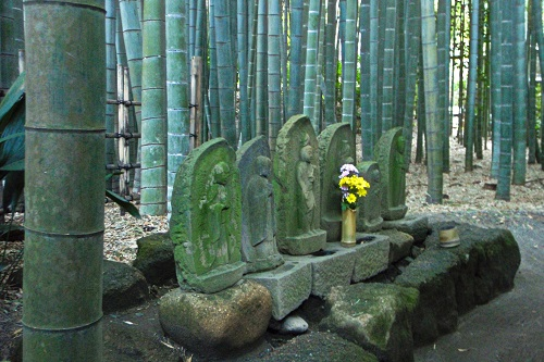 Statues in bamboo forest at Hokokuji temple in Kamakura, Japan