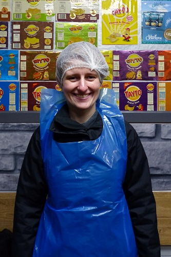 Maddy wearing protective hat and apron ready for Tayto Castle tour in Northern Ireland