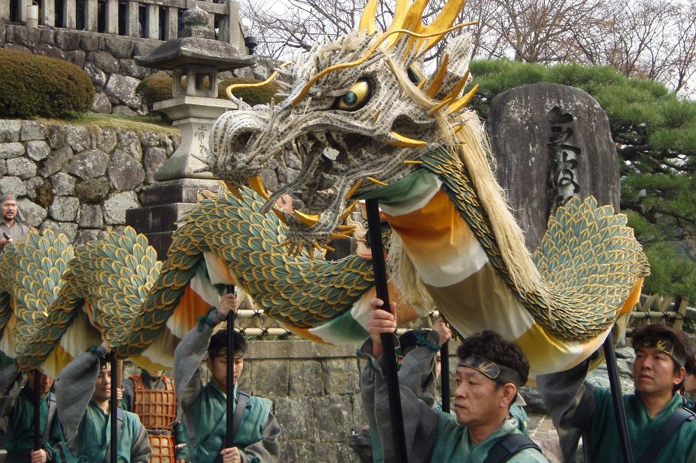 Men parading with a dragon at Seiryu-e festival in Kyoto, Japan