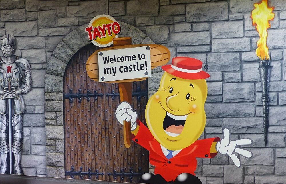 Wall art of Mr Tayto entering his castle in Tandragee, Northern Ireland