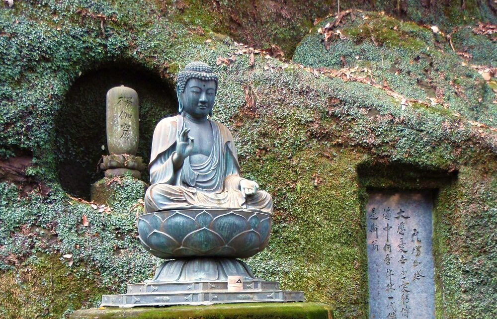 Seated Buddha practising zazen at Tokei Ji temple in Kamakura, Japan