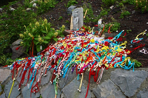 Piles of bells on the path up Mount Fuji, Japan