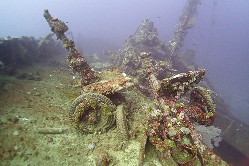 Field guns scattered on the deck of Nippo Maru in Truk Lagoon, Chuuk