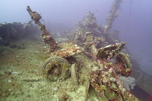 Field guns scattered on the deck of Nippo Maru in Truk Lagoon, Chuuk