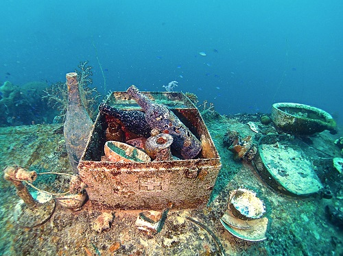 Metal medical box filled with bottles and bowls on Shinkoku Maru in Chuuk Lagoon, Micronesia