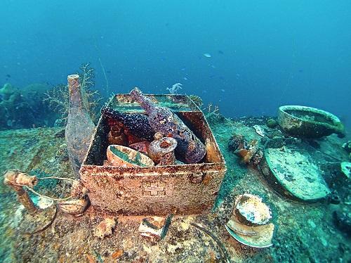 Metal medical box filled with bottles and bowls on Shinkoku Maru in Chuuk Lagoon, Micronesia