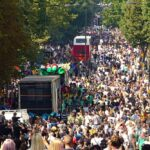 Crowded street and parade floats at Notting Hill Carnival in London, England