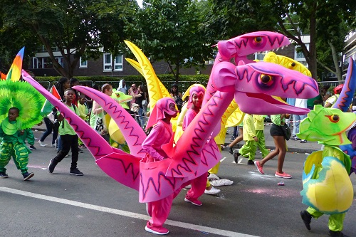 Pink dinosaurs at Notting Hill Carnival in London, England