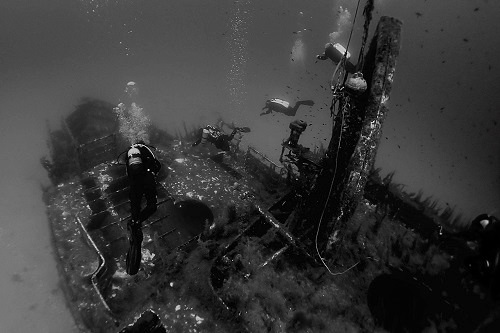 Divers descending onto wreck of MV Karwela in Gozo