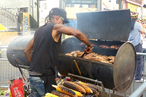 Man barbecuing jerk chicken at Notting Hill Carnival, London, England