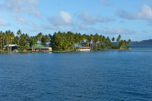 Low building and palm trees at Blue Lagoon Resort in Chuuk, Micronesia
