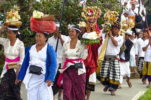 Procession of people bringing offerings to Ulun Danu Bratan temple in Bali, Indonesia