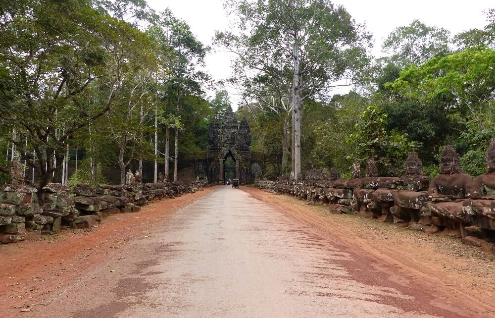 Cycling across bridge to Angkor Thom North Gate near Siem Reap, Cambodia