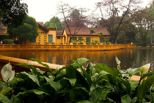 Fish pond and yellow house at Ho Chi Minh's Mausoleum in Hanoi, Vietnam