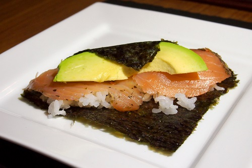 Salmon and avocado temakizushi partly rolled