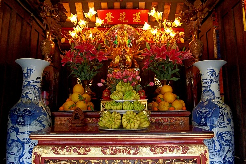 Fruit offerings inside the One Pillar Pagoda in Hanoi, Vietnam