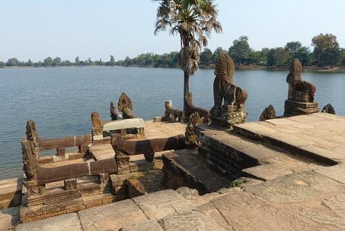 Statues seen cycling past Sras Srang near Siem Reap, Cambodia