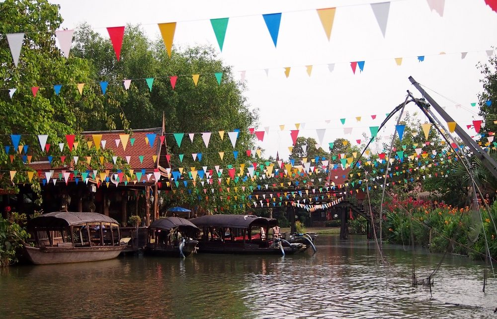 Entrance booth, bunting and boats at Ayutthaya Floating Market in Thailand