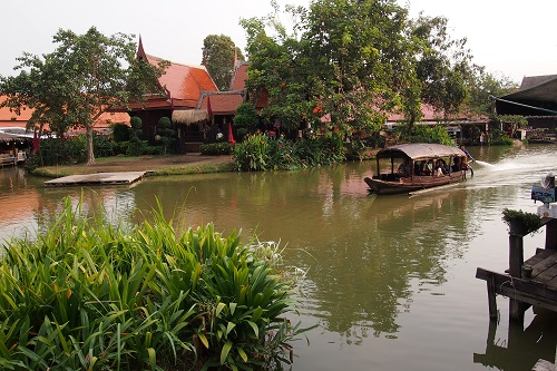 Boat cruising on the canal at Ayutthaya Floating Market in Thailand