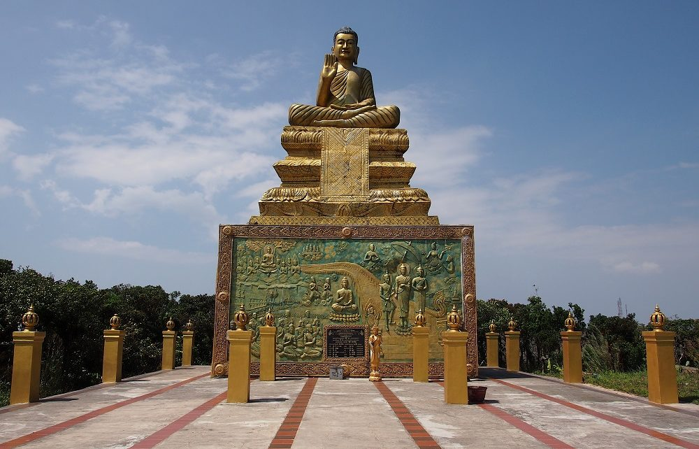 Golden Buddha on the mountaintop at Bokor Hill Station in Cambodia
