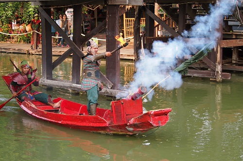 Cannon firing from a small boat at Ayutthaya Floating Market in Thailand