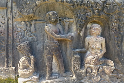 Holy man and hero rock carvings at Yeh Pulu in Bali, Indonesia