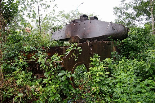 Tank lost in undergrowth at Doc Mieu Base in the DMZ, Vietnam