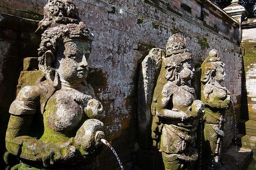 Fountain statues around Goa Gajah bathing pool in Bali, Indonesia