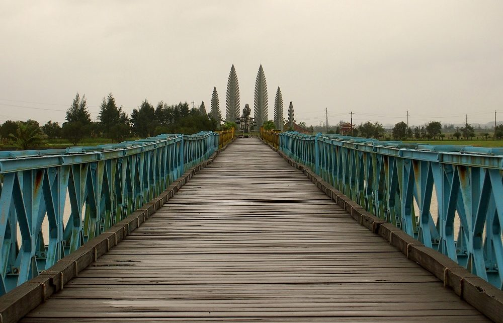View across Hien Luong bridge to the monument to families in the DMZ, Vietnam