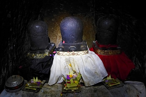 Hindu trinity lingam in elephant cave at Goa Gajah in Bali, Indonesia