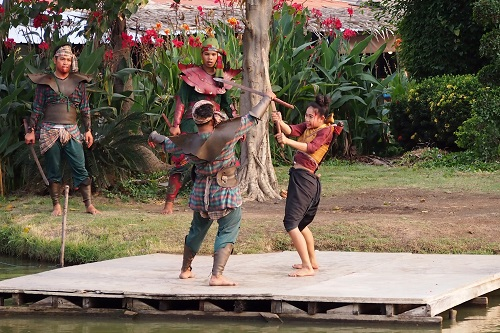 Sword fighting actors at Ayutthaya Floating Market in Thailand
