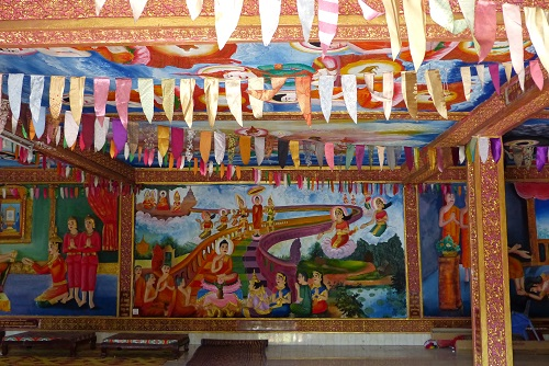 Colourful murals and bunting inside the new temple at Bokor Hill Station in Cambodia