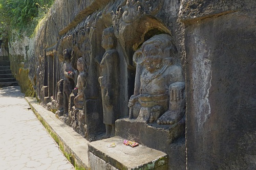 Long frieze of rock carvings at Yeh Pulu in Bali, Indonesia