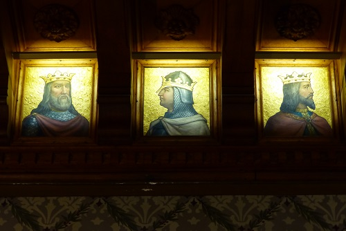 Pictures of three Portuguese kings in the Billiards Room at Quinta da Regaleira palace in Sintra, Portugal