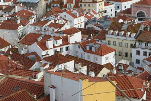 View over rooftops of Alfama from Miradouro das Portas do Sol viewpoint in Lisbon, Portugal